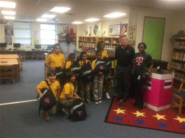 T-Mobile Donates Backpacks to Logan